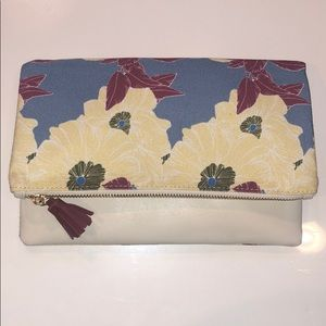 White pleather & floral reversible clutch